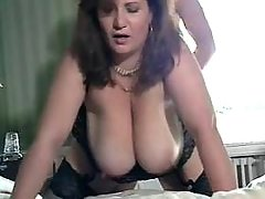 Chubby mature gets cum on huge tits